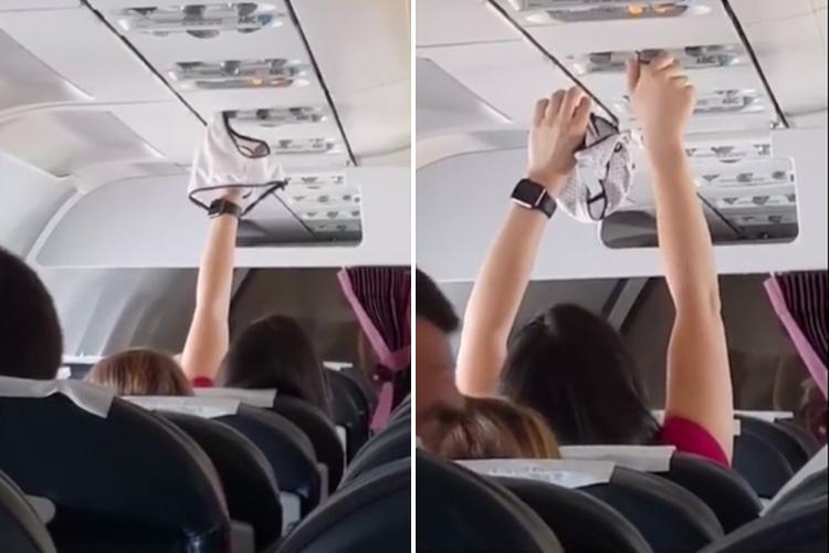Bizarre moment female air passenger is caught on camera using an overhead air vent to dry her knickers