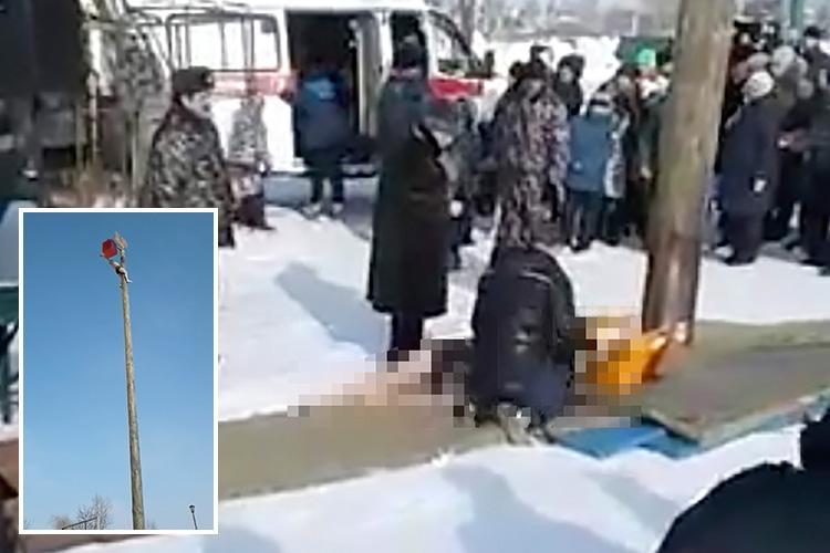Horrific moment man is left seriously injured after falling 23ft from a pole during a Russian folk festival marking the end of winter