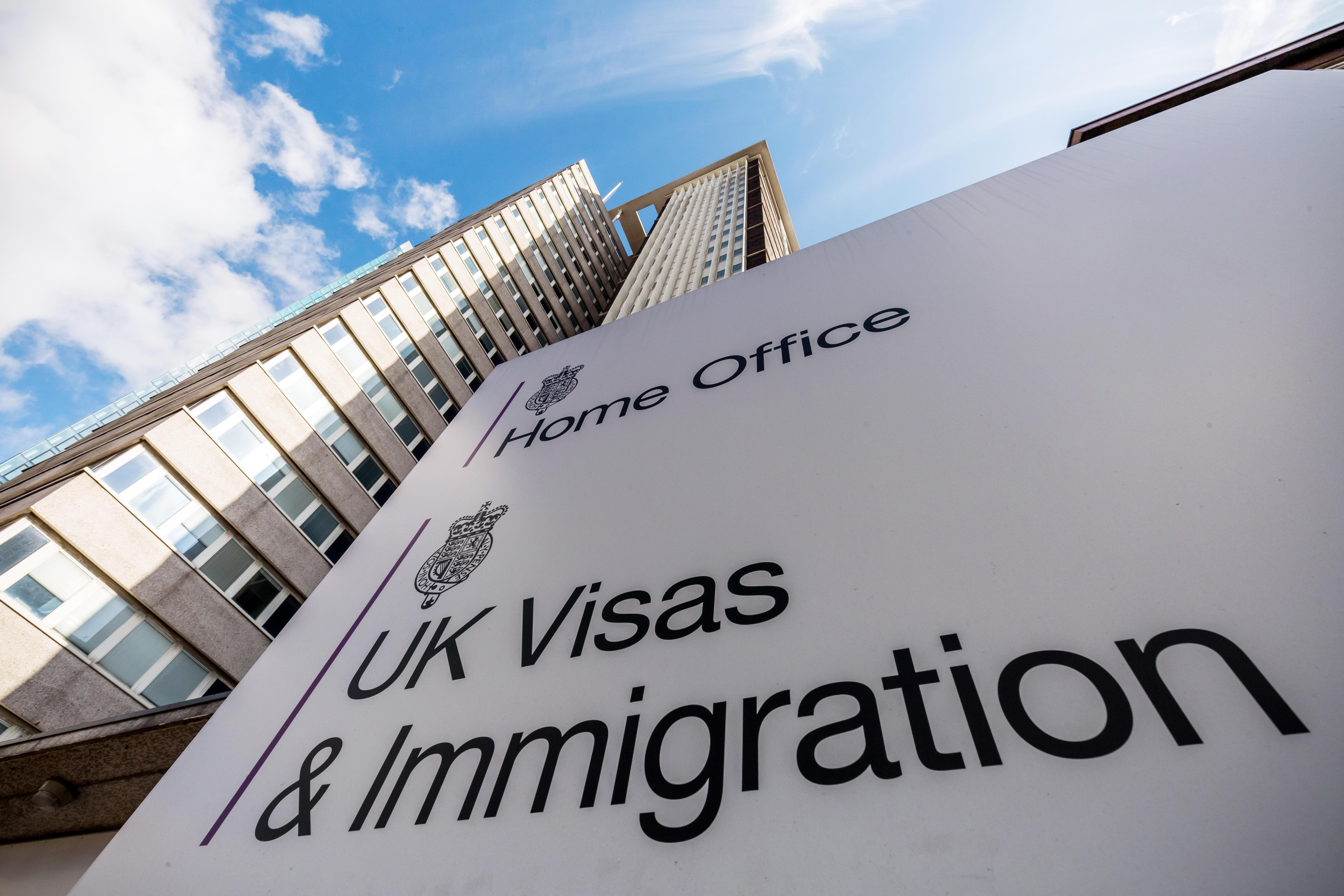 Illegal immigrant suspects allowed to stay in Britain for up to eight years because dozy mandarins 'refuse to process their cases'