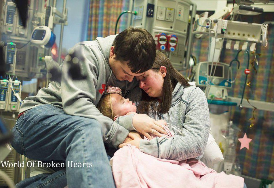 Agonising photos show two-year-old dying in her parents' arms as she waited for heart transplant