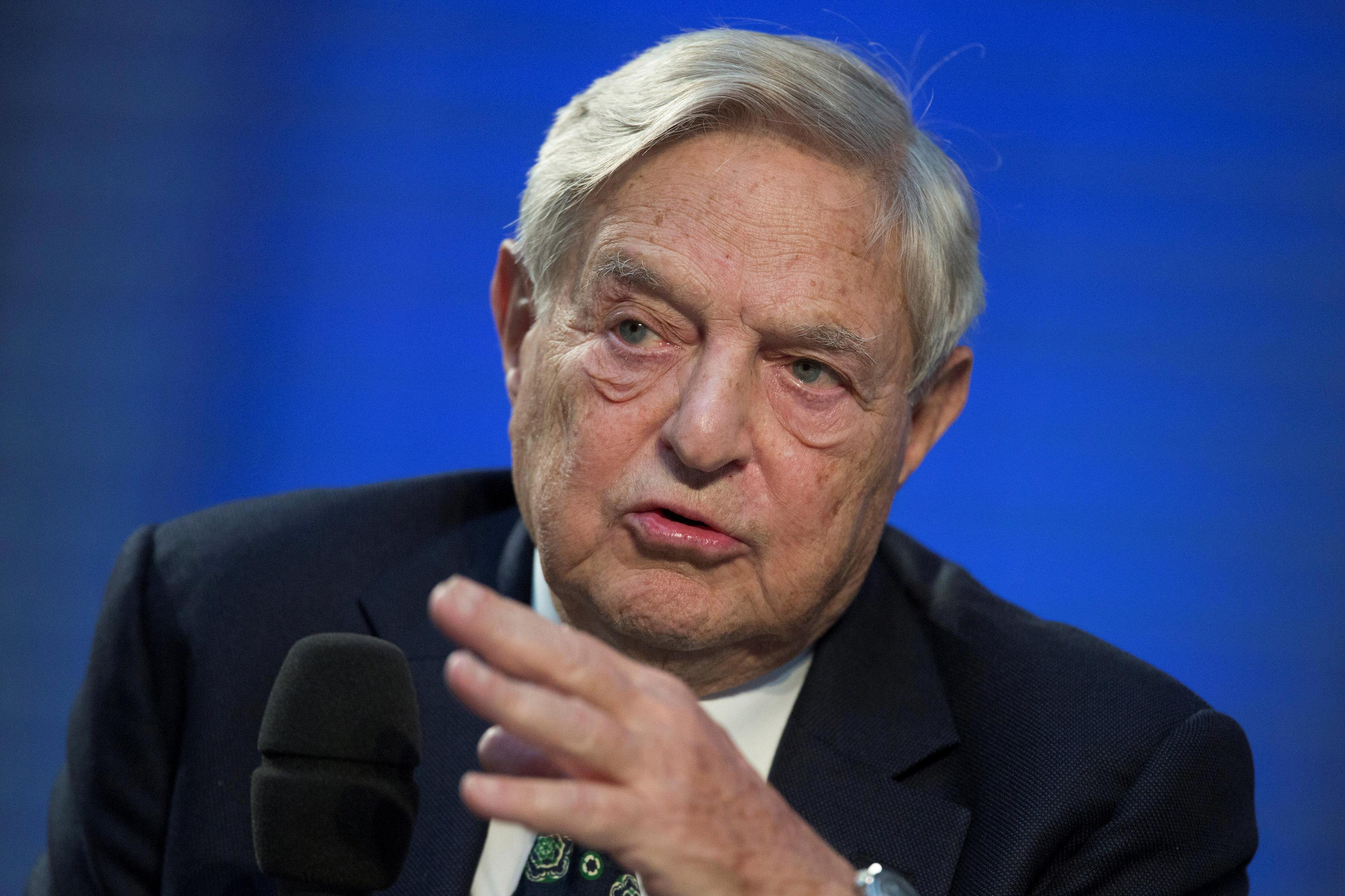 Billionaire George Soros defends £400,000 donation to pro-EU campaign and claims 'love for Britain' is behind anti-Brexit drive