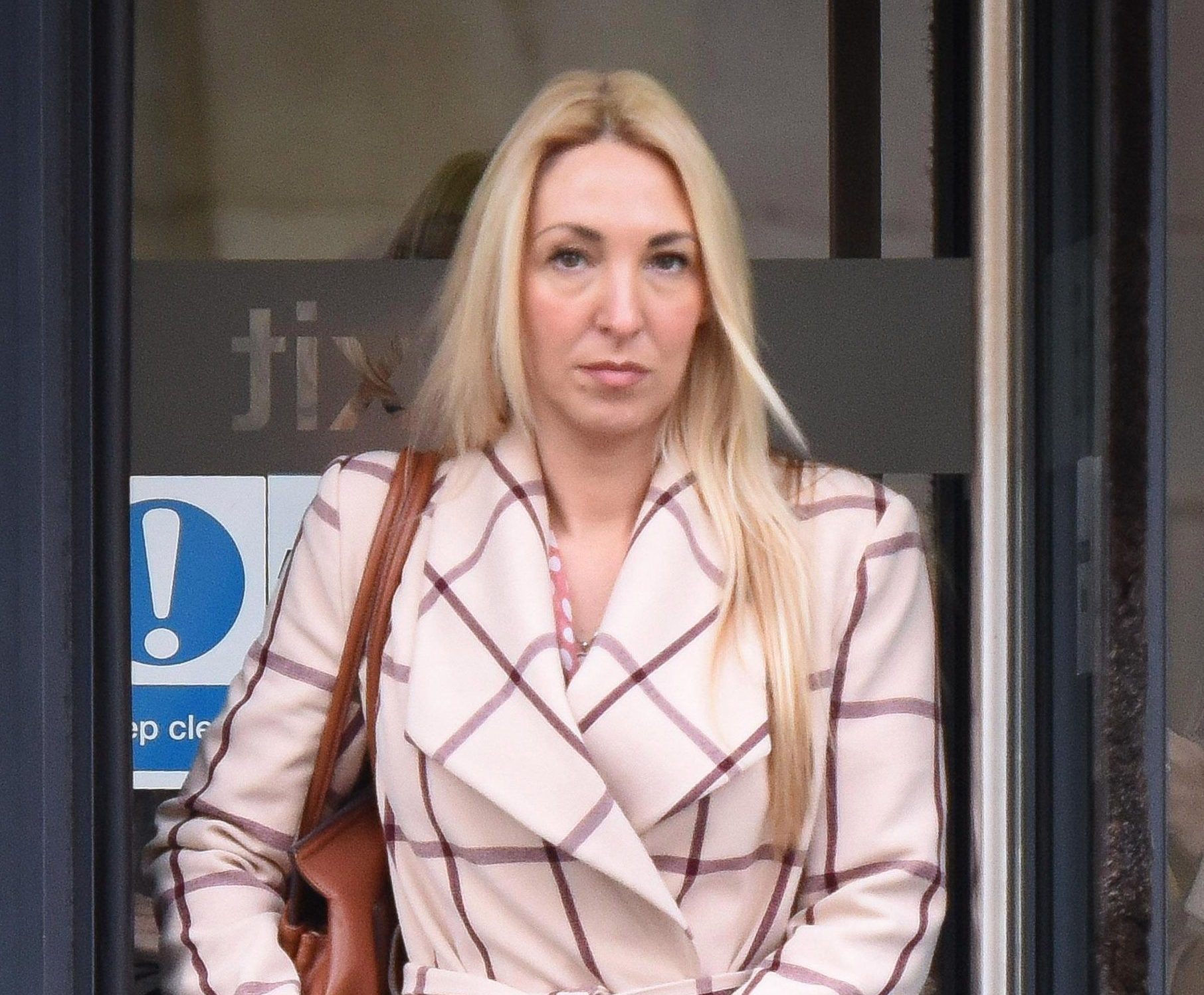 Female cop claims superior 'pestered her for sex and squeezed her bum'