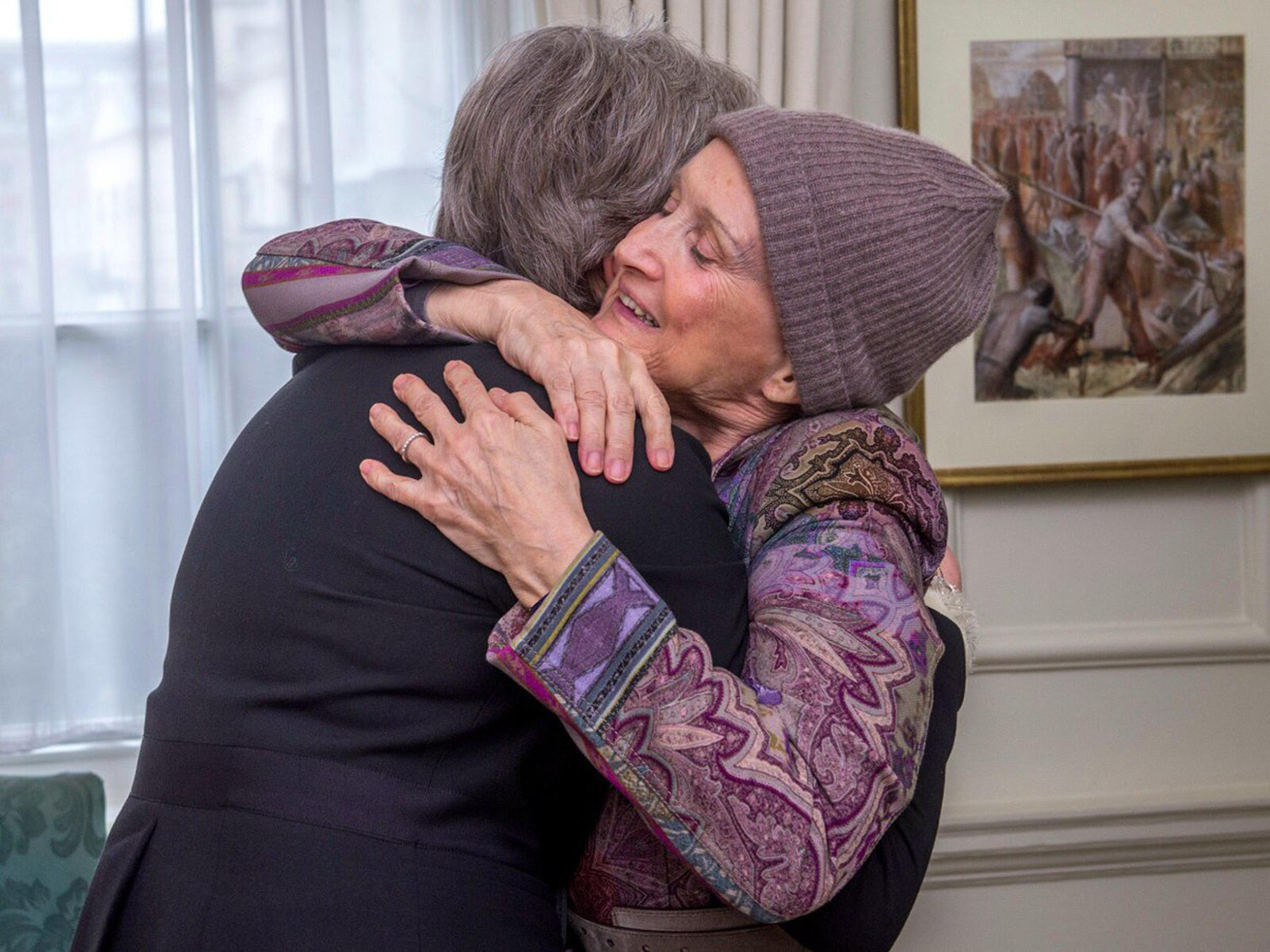 Theresa May shares emotional embrace with cancer-fighting ex-minister Tessa Jowell as she announces new £45m research fund