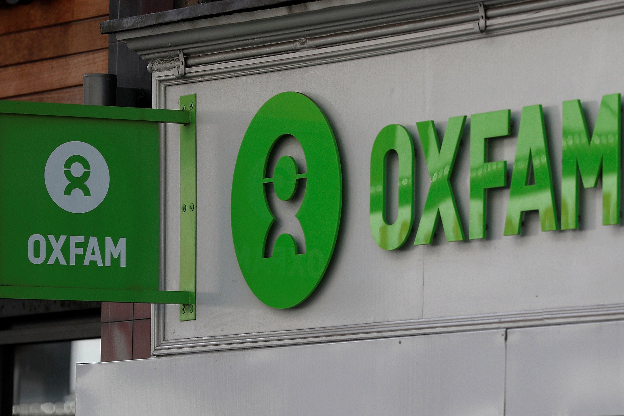 UK threatens to cut charity aid cash after Oxfam sex abuse report
