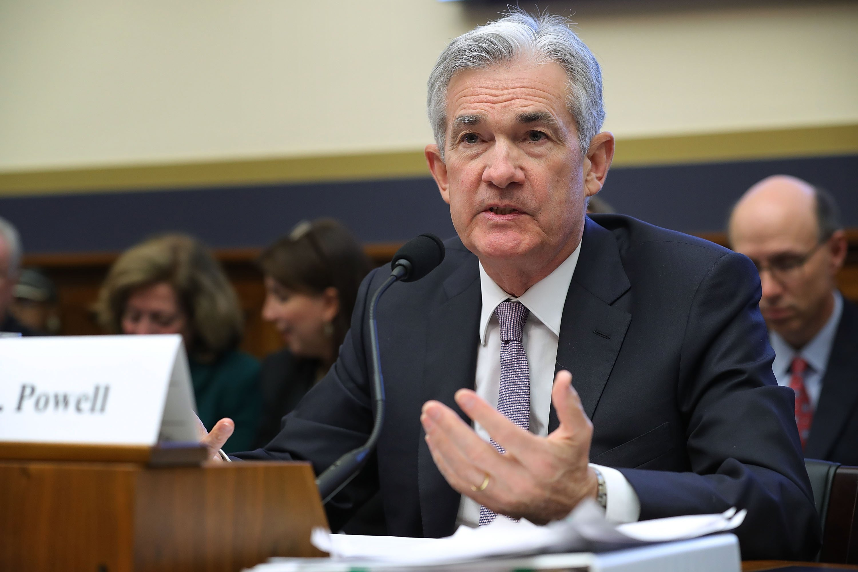 Dow tumbles nearly 300 points on new Fed chair's comments