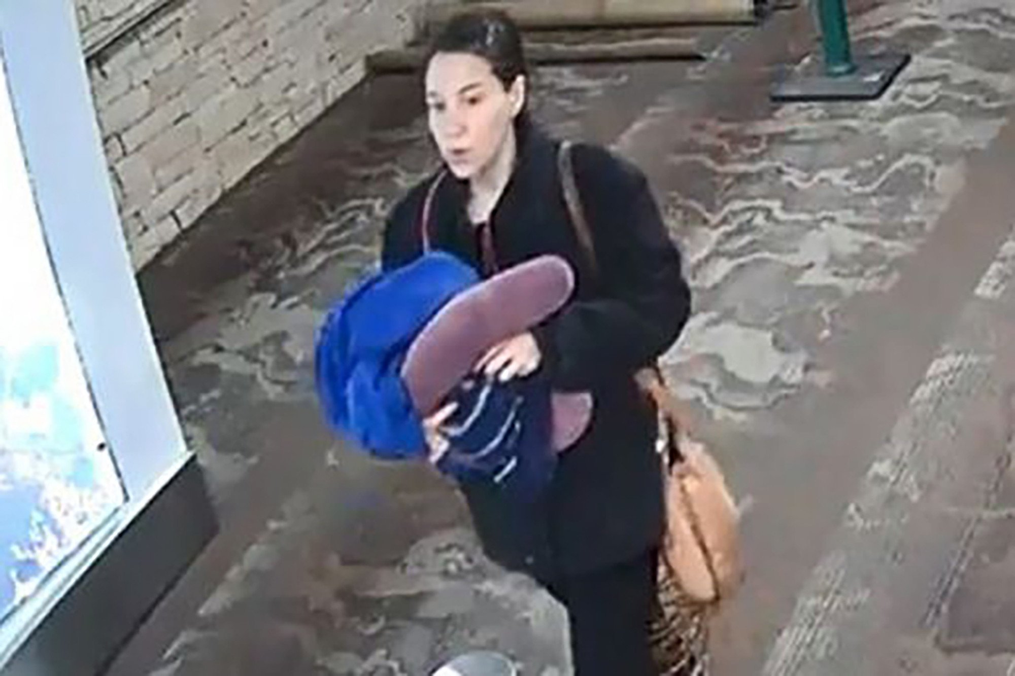 Woman accused of abandoning newborn at airport seen on video