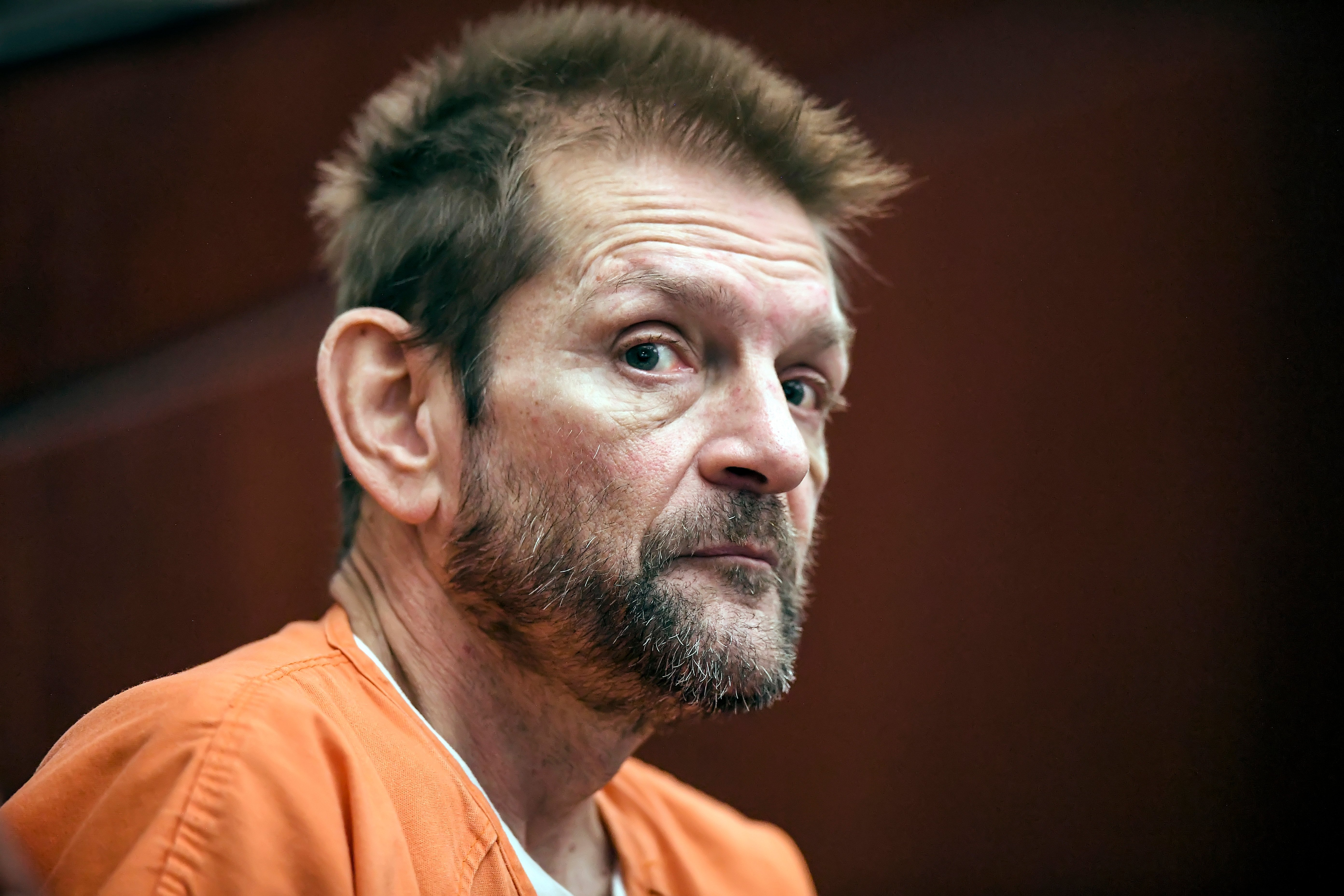 Bar gunman who yelled 'Get out of my country' pleads guilty to murder