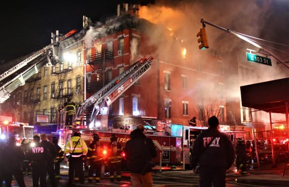 Eight people hurt in four-alarm building blaze