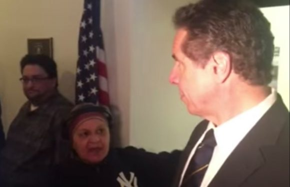Unhinged woman takes swing at Cuomo during press conference
