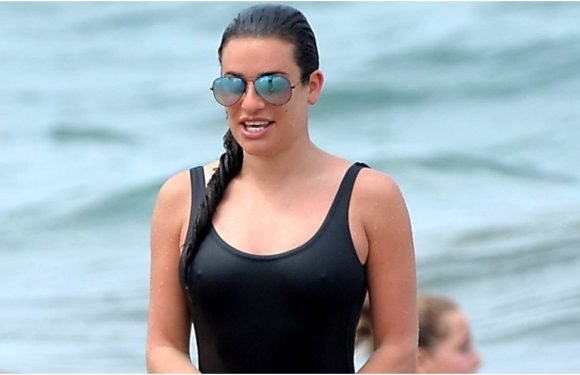 Lea Michele's Simple Black Swimsuit Has a Hell of a Twist From Behind