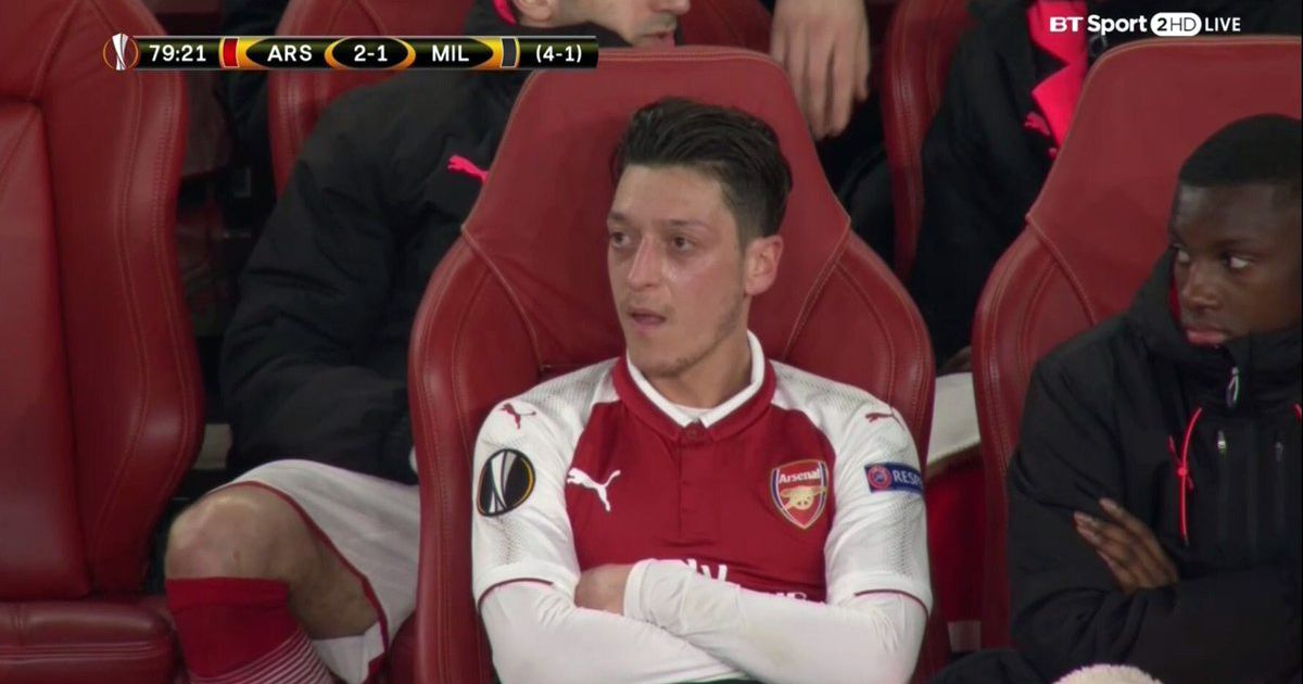 Fans notice what Nketiah was doing while sat on bench next to Ozil