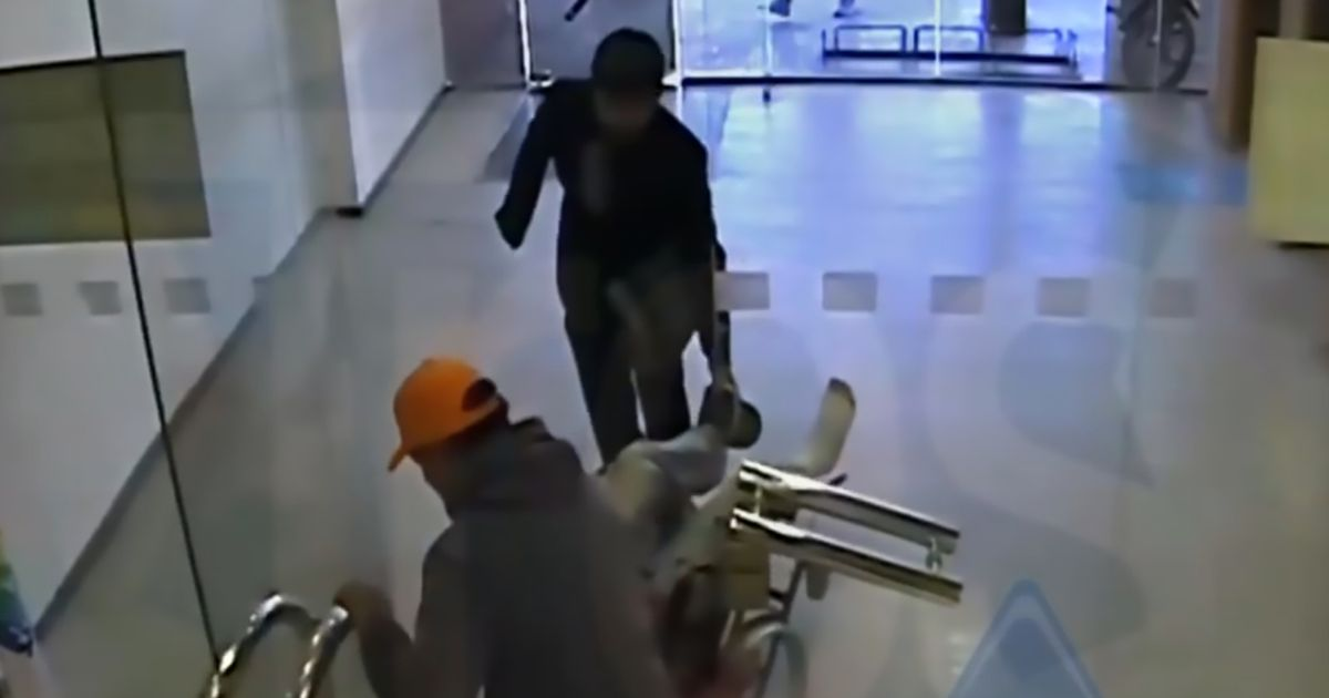 Robber pushed into bank in wheelchair before gang pulls off terrifying heist