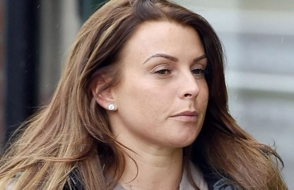 Coleen Rooney flaunts slim figure and hints Wayne is back in good books