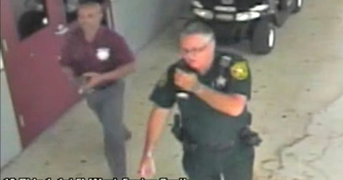 Video shows armed cop outside Florida school doing nothing as massacre unfolded