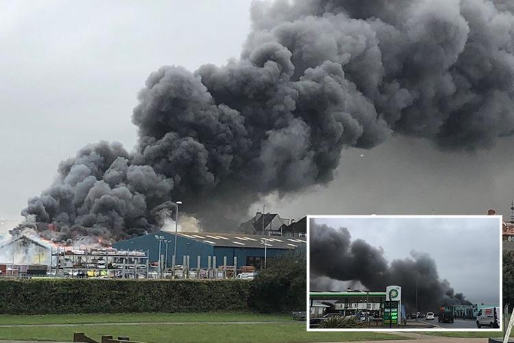 Hove fire breaks out causing huge plume of smoke over East Sussex town