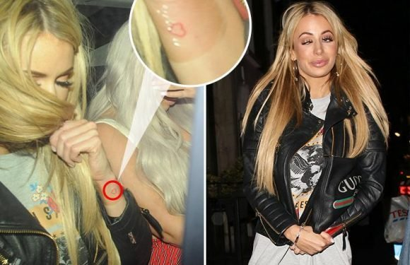 Olivia Attwood looks sloshed as she shows off new heart tattoo on wild night out with mystery man at Charlotte Crosby's party