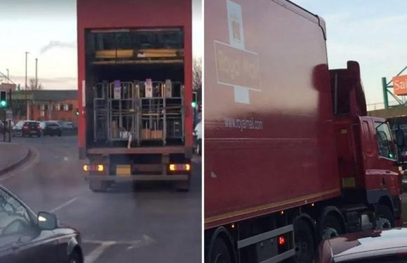 Royal Mail lorry spotted with back doors wide open and 'parcels hanging out' on busy roundabout