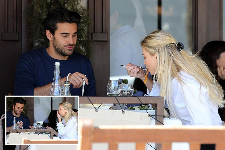 Georgia Toffolo slurps spaghetti as she enjoys date with a mystery hunk at Italian restaurant