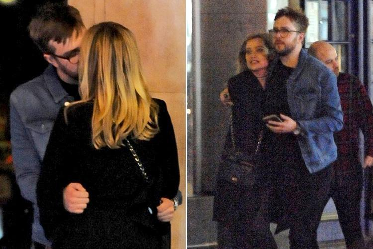Laura Whitmore and Iain Stirling can't keep their hands off each other as they kiss and cuddle on date night in London