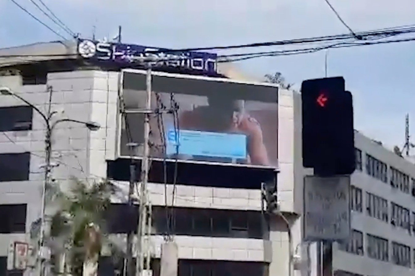 Porn video appears on billboard at busy intersection