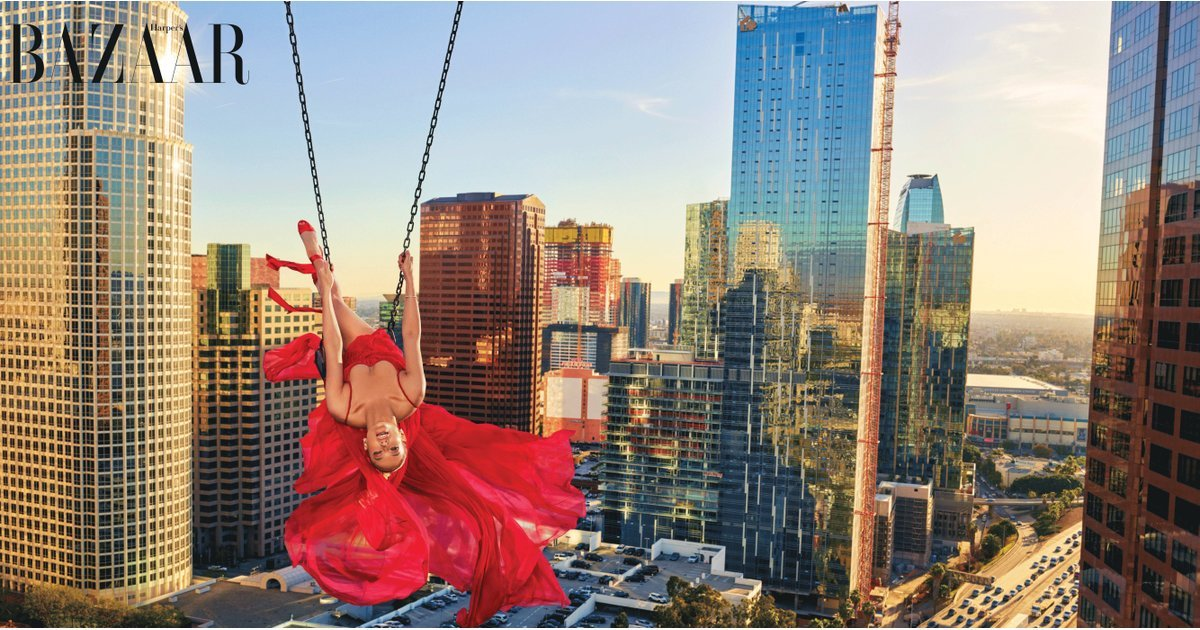 Leave It to Jennifer Lopez to Pull Off a Gorgeous Gown While Literally Swinging Off a Building