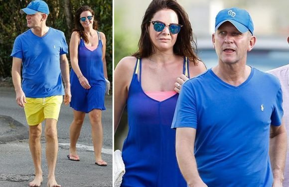 Jeremy Kyle goes barefoot for a laid back stroll with fiance Vicky Burton as they soak up the sun in Barbados