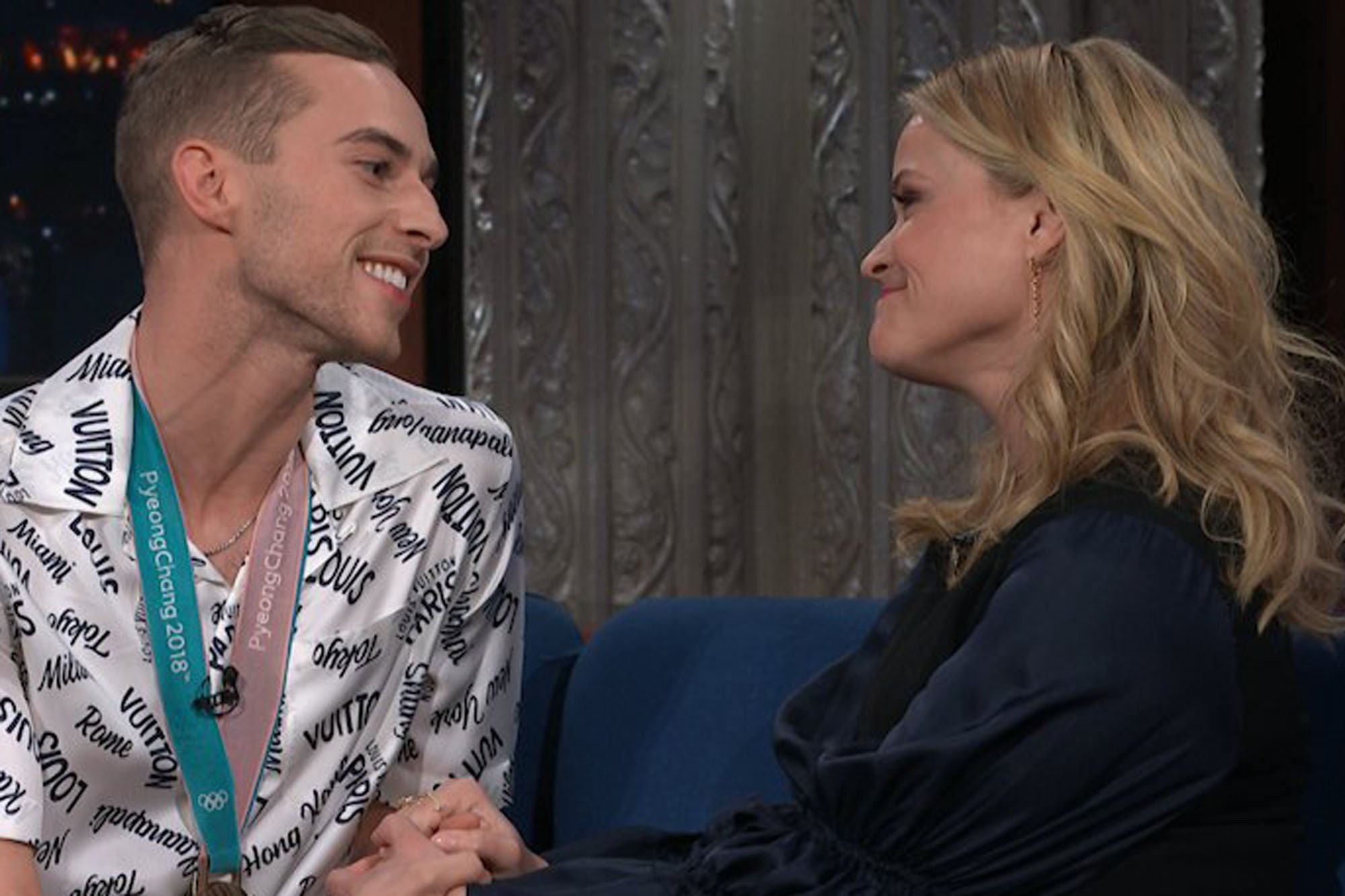 Adam Rippon has a moment with Reese Witherspoon on 'Colbert'