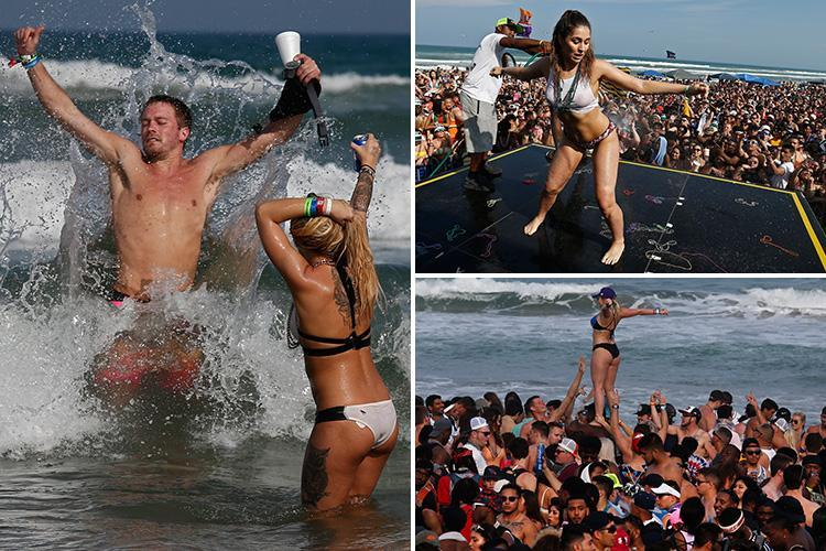 Bikini-clad Spring Breakers drink beer and let loose as 18,000 party on South Padre Island in Texas