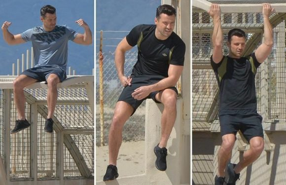 Mark Wright shows off his muscles as he strikes a moody pose for Umbro shoot in LA