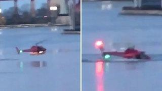 Tourist helicopter plunges into New York's East River killing all five passengers as dramatic footage shows moment chopper crash-landed