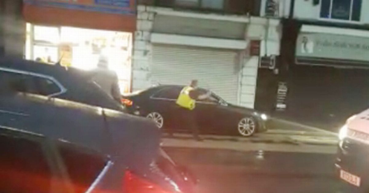Brave police officer tries to smash ram raiders getaway car after jewellery raid