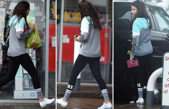 Michelle Keegan braves the English rain as she spends Easter Bank Holiday alone without LA-based husband Mark Wright