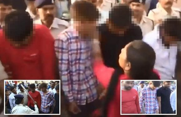 'Gang rapists' slapped and beaten by furious women in the street after they're arrested for 'brutally attacking female student'