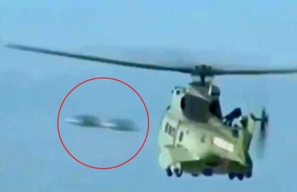 Bizarre moment 'UFOs' spotted speeding past helicopter as it hovers over crash site helping survivors
