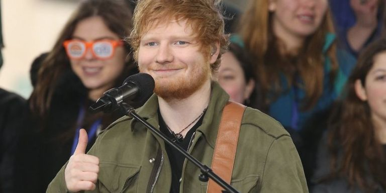 Ed Sheeran calmly carries on after a fan invades the stage during Perth gig