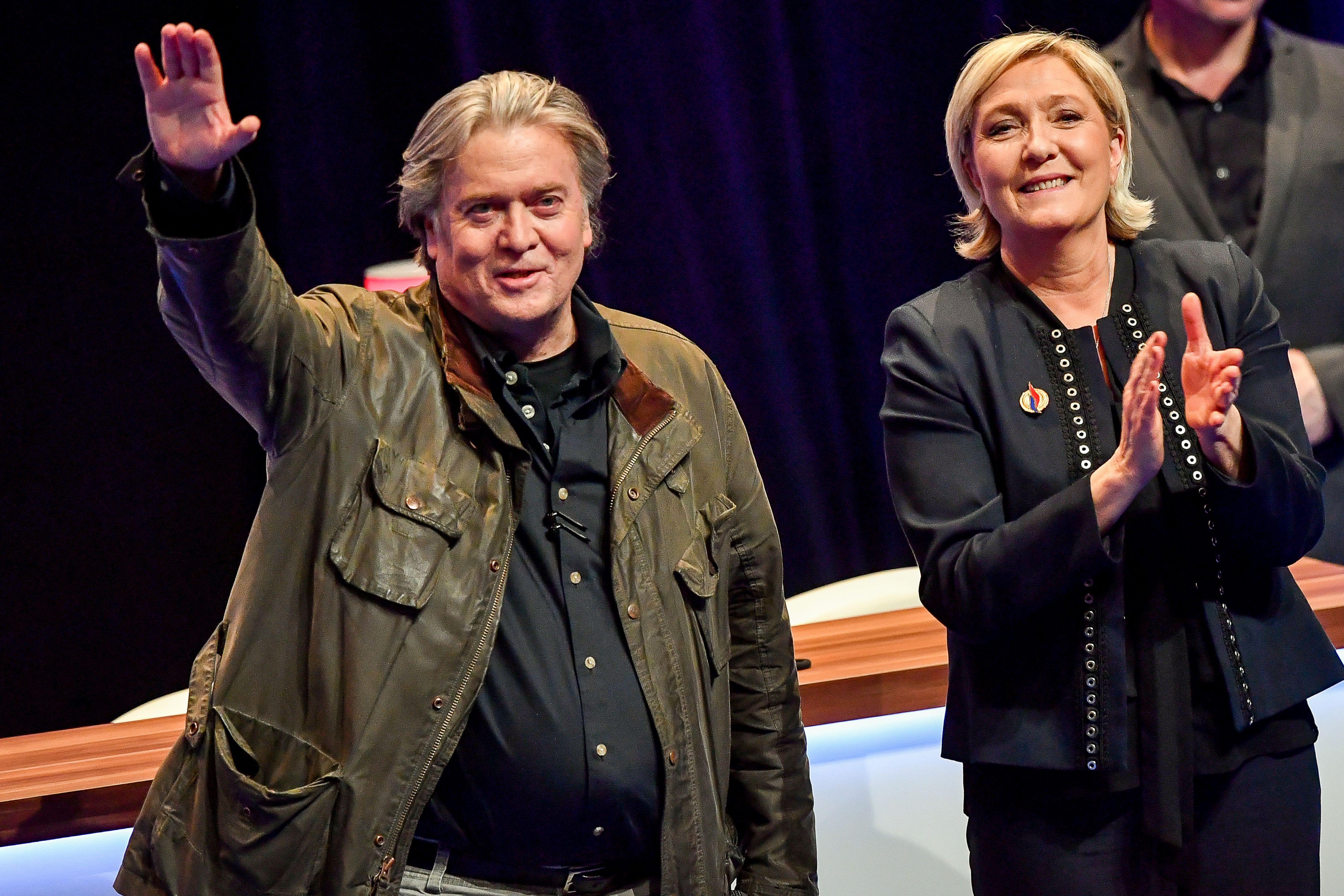 Marine Le Pen re-elected unopposed as leader of France's Front National after Steve Bannon says to wear 'racist' tag like 'badge of honour'