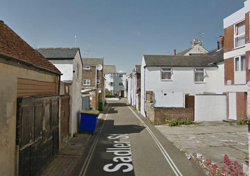 Woman found dead in the middle of Sussex street wearing just a dressing gown