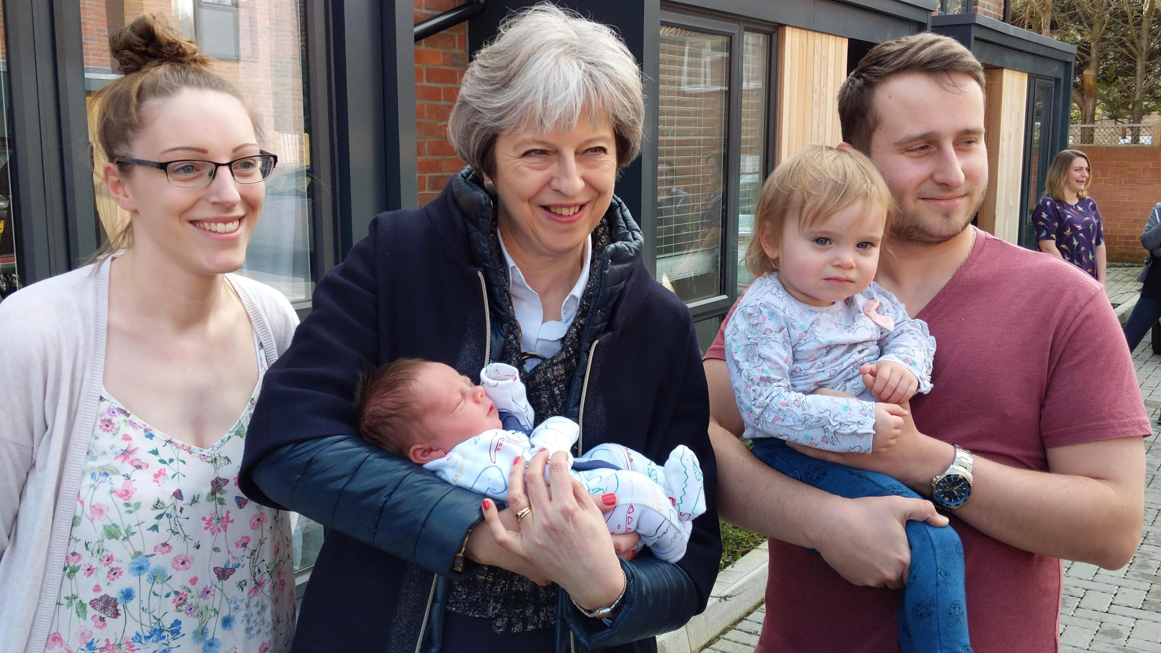 Theresa May continues to kill off the 'Maybot' with baby photo-op after fist-bumping voter in Salisbury as strong stance on Russia sees poll boost