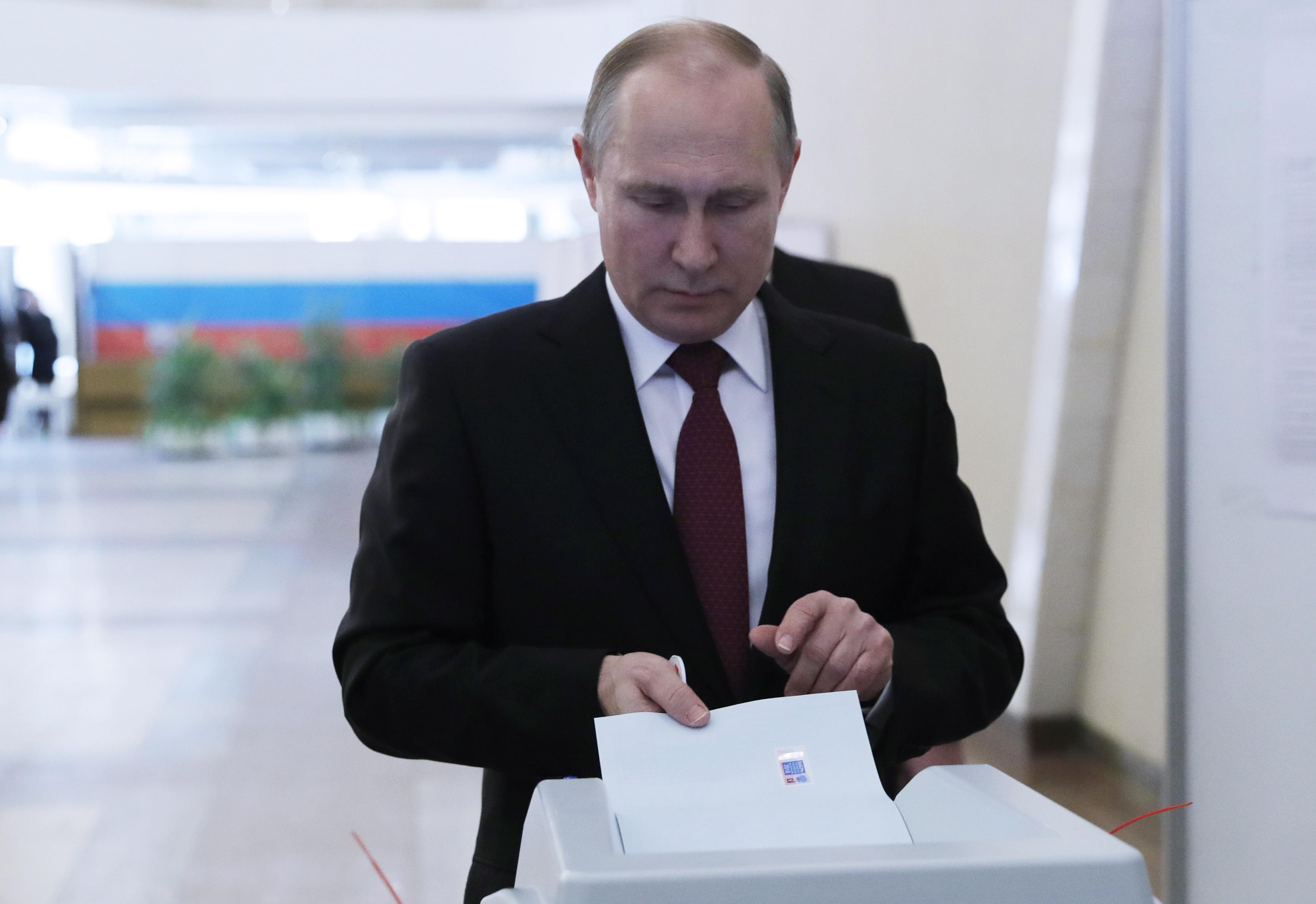 Russia election hit by huge cyber attack attempting to cripple computers as voters go to the polls