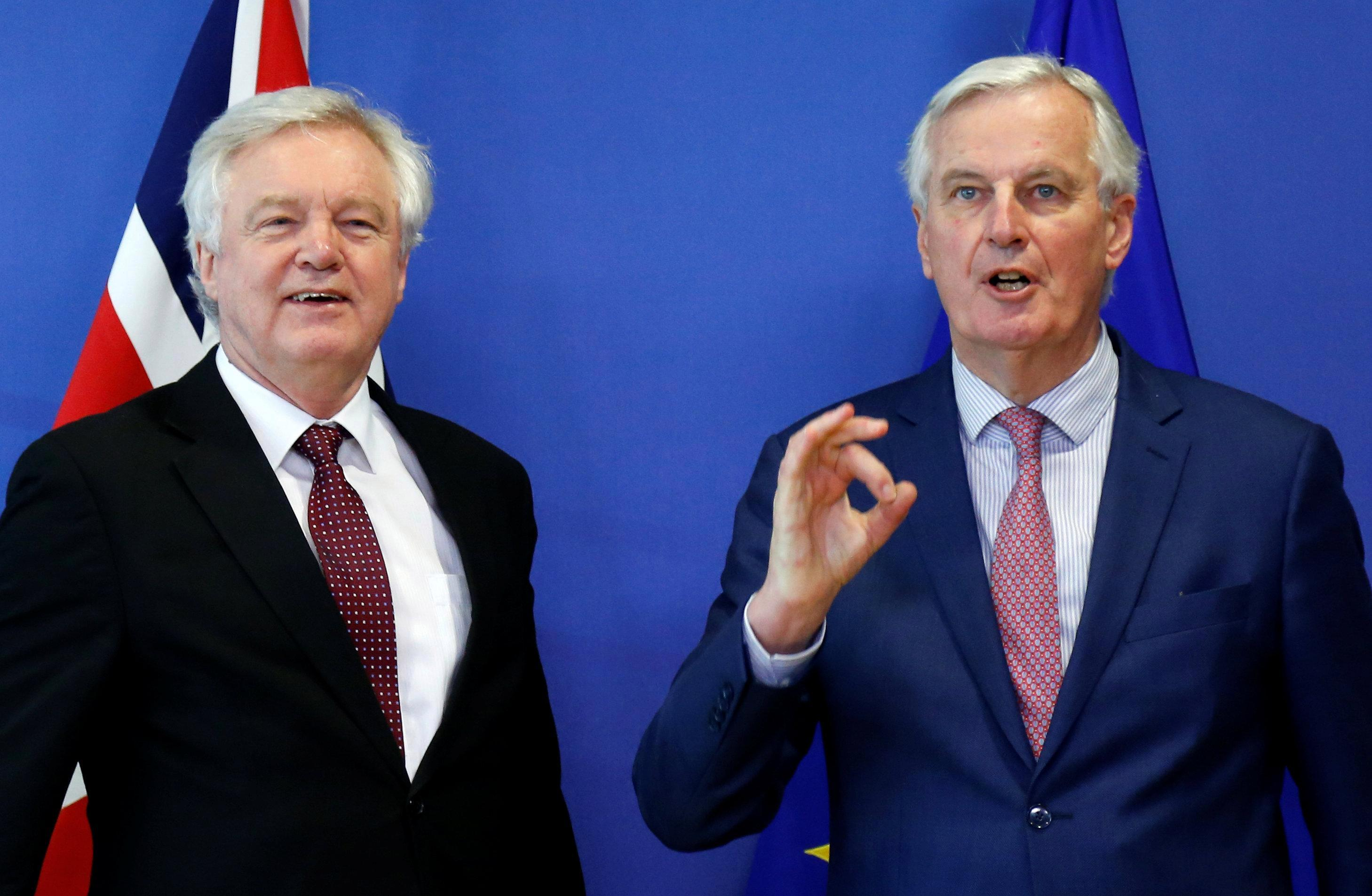 Michel Barnier confirms UK will exit EU for good on New Year's Eve 2020 after transition deal agreed in Brussels – but Irish border issue still not solved