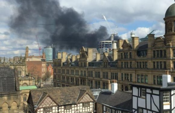 Manchester city centre clouded in plumes of black smoke following 'huge fire'