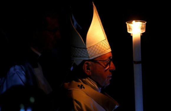 Pope baptizes Italy 'migrant hero' at Easter Eve service