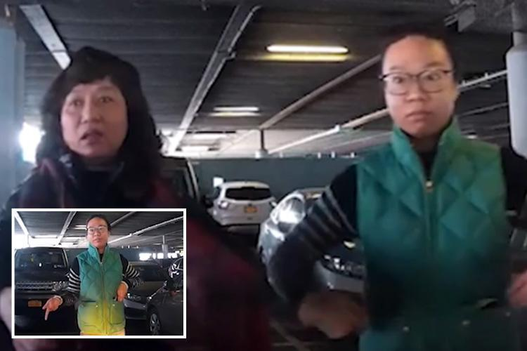 Defiant women stand in parking space and refuse to move because it's already 'taken' – despite not having a car