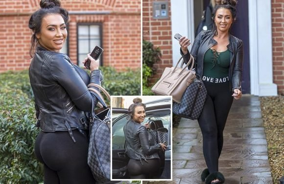 Lauren Goodger looks like she's been tangoed as she shows off her bum in see-through leggings