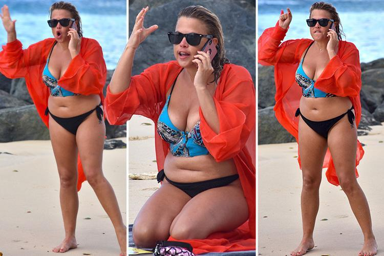Bikini-clad Nadia Essex rages in a furious phone call on the beach in Barbados