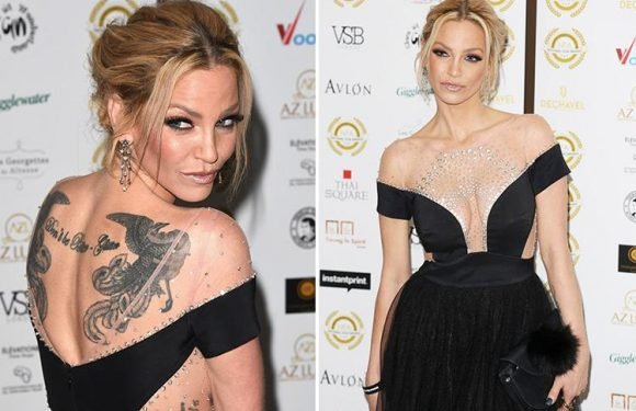 Sarah Harding reveals HUGE back tattoo in glamorous black dress at National Film Awards