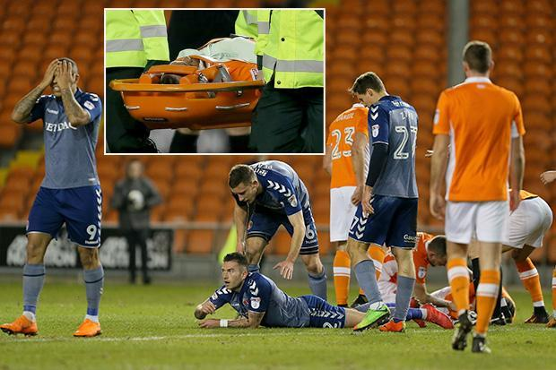Nathan Delfouneso taken off on stretcher after clash of heads with Lewis Page