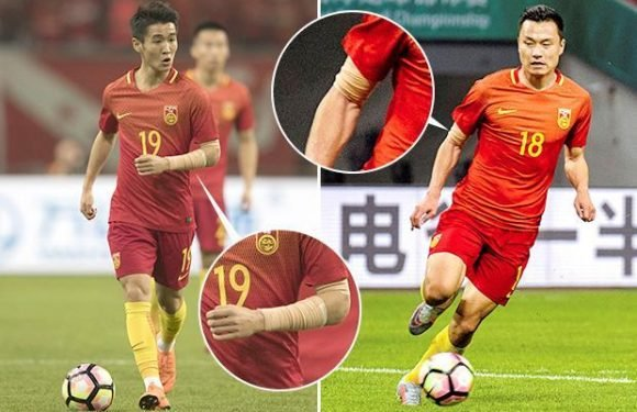 Chinese government 'bans tattoos on footballers' — with players forced to cover up ink in friendly loss to Wales
