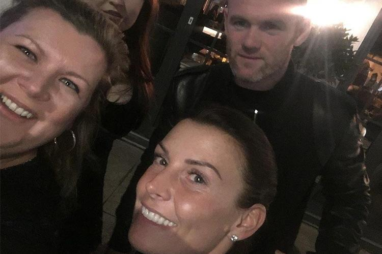 Coleen and Wayne Rooney look closer than ever as they enjoy a rare night out following footballer's drink-drive scandal