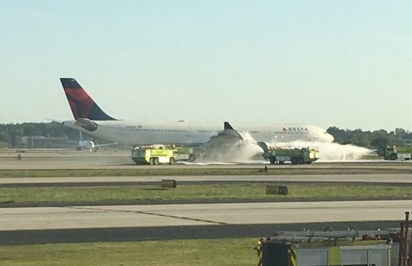 Smoke pours from Delta jet following emergency landing day after Southwest drama